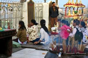 Praying in Kyaiktiyo